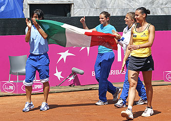 Italy's Francesca Schiavone (left) Roberta Vinci (2nd left), Sara Errani and Flavia Pennetta (right) celebrate after winning their Fed Cup World Group semi-final match against Czech Republic