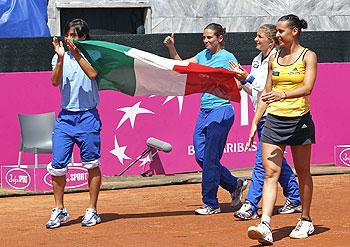 Italy's Francesca Schiavone (left) Roberta Vinci (2nd left), Sara Errani and Flavia Pennetta (right) celebrate after winning their Fed Cup World Group semi-final match against Czech Republic