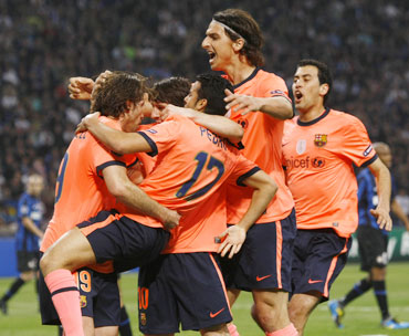 Barcelona players celebrate after scoring against Inter