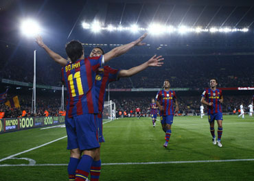Barcelona players celebrate after a goal