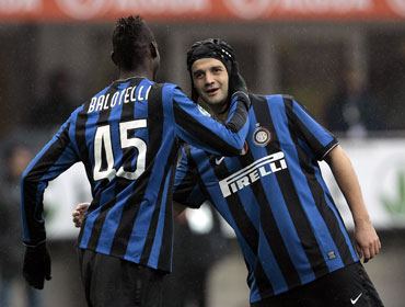 Cristian Chivu and Mario Balotelli