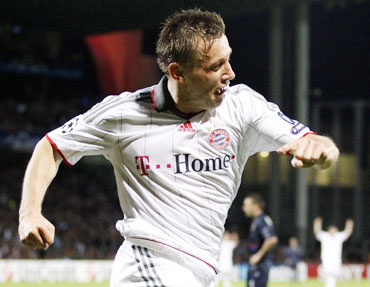 Ivica Olic of Bayern Munich celebrates after scoring against Olympique Lyon