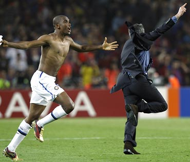 Samuel Eto'o (left) celebrates with coach Jose Mourinho