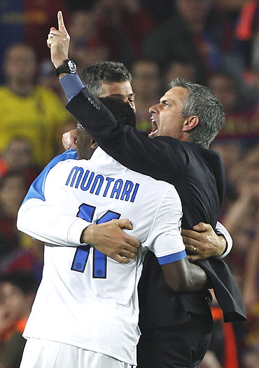 Inter Milan's coach Jose Mourinho (right) celebrates with his players after qualifying for the Champions League final