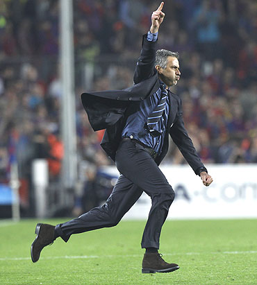 Jose Mourinho celebrates after qualifying for the final