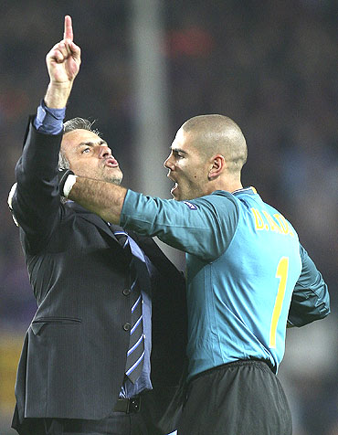 Jose Mourinho (left) gets into a tussle with Barcelona goalkeeper Victor Valdes as he celebrates after qualifying for the Champions League final