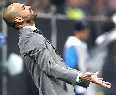 Barcelona coach Guardiola reacts during the match against Inter Milan