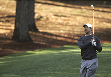 Tiger Woods watches his shot from the third fairway during a pro-am event before play in the Quail Hollow Championship