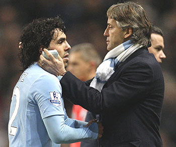 carlos tevez (left) with roberto mancini