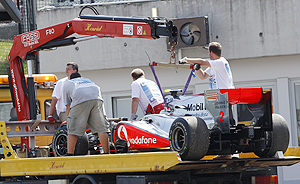 Lewis Hamilton's car is removed from the race track on Sunday