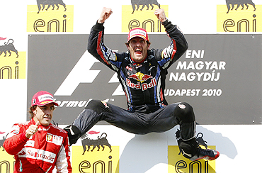 Red Bull's Mark Webber (right) and Ferrari's Fernando Alonso celebrate on the podium after the Hungarian GP
