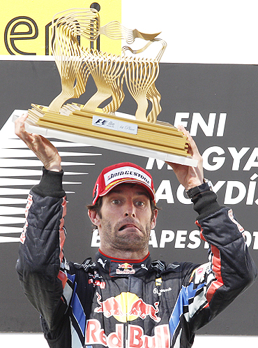Mark Webber with his trophy