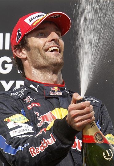 Mark Webber celebrates his win in Hungary
