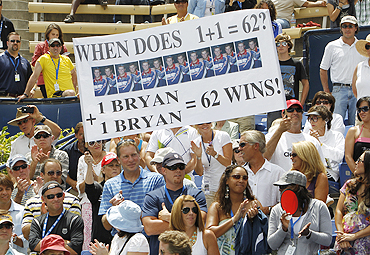 Fans of the Bryan twins hold a placard during the final on Sunday