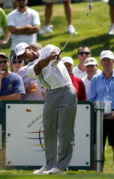 Tiger Woods hits his tee shot on the seventh hole during first round play at the WCG Bridgestone Invitational