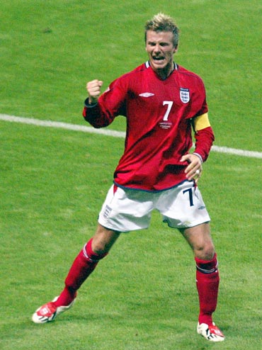 David Beckham celebrates scoring a penalty against Argentina in the 2002 World Cup