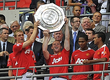 Manchester United players celebrate after winning Community Shield