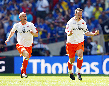 Blackpool's Charlie Adam (right) and Stephen Crainey celebrate