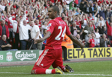 Liverpool's David Ngog celebrates after scoring against Arsenal