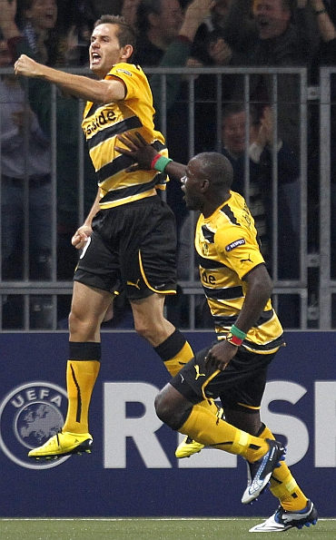 BSC Young Boys (YB)'s Senad Lulic and Henri Benvenue celebrate after scoring a goal against Tottenham Hotspurs