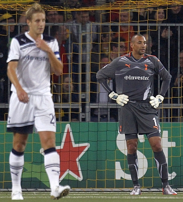 Tottenham Hotspur's goalkeeper Gomes reacts after BSC Young Boys scored their third goal