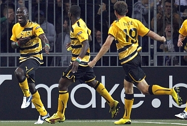 BSC Young Boys Benvenue and team-mates celebrate after scoring the second goal against Tottenham Hotspur
