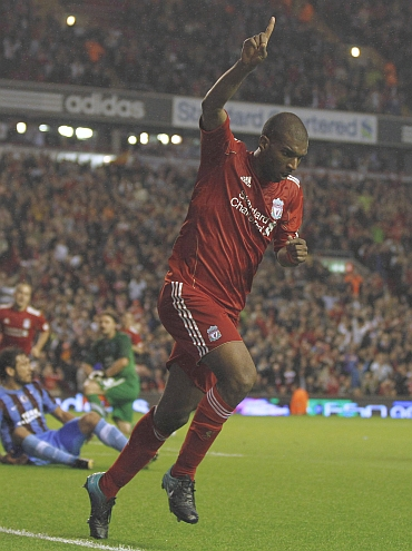 Liverpool's Ryan Babel celebrates scoring against Trabzonspor