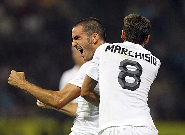 Juventus' Bonucci and Marchisio celebrate after Bonucci scored a goal during their Europa League playoff match in Graz