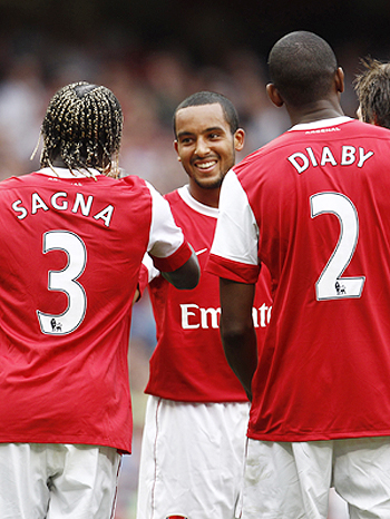 Arsenal's Theo Walcott (centre) celebrates with teammates after scoring against Blackpool during their English Premier League match at The Emirates Stadium on Saturday