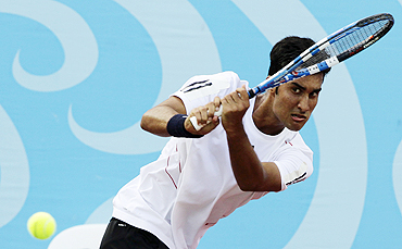 India's Yuki Bhambri returns to Colombia's Juan Sebastian Gomez during their men's singles final at the Singapore 2010 Youth Olympic Games on Saturday