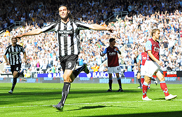 Newcastle United's Andy Carroll (2nd L) celebrates after scoring against Aston Villa on Sunday