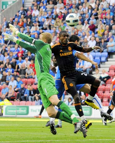 Salomon Kalou (right) heads to score against Wigan Athletic