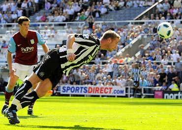 Newcastle United's Kevin Nolan (right) heads to score against Aston Villa