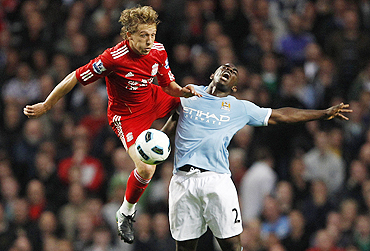 Manchester City's Micah Richards (right) and Liverpool's Lucas vie for possession