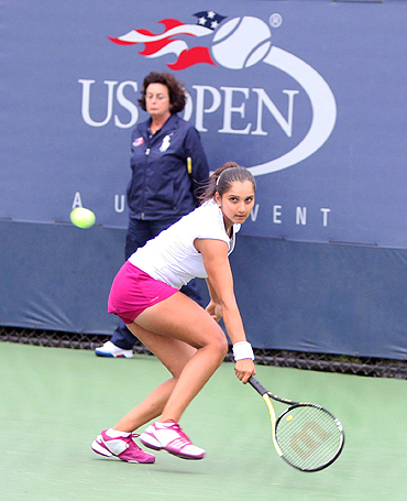 Sania Mirza in action against Ksenia Lykina of Russia