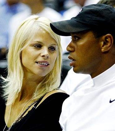 Tiger Woods with his wife Elin Nordegren