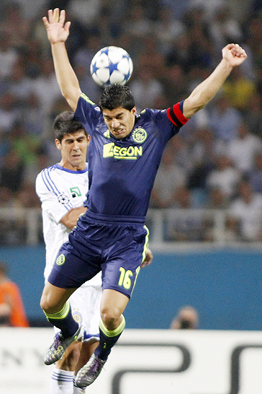 Ajax Amsterdam's Luis Suarez (right) is challenged by Dynamo Kiev's Leandro Almeida