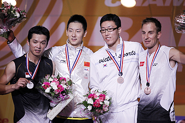 Indonesia's Taufik Hidayat, China's Chen Jin, South Korea's Park Sung-hwan and Denmark's Peter Hoeg Gade pose on podium after receiving their medals at the 2010 Badminton World Championships in Paris on Sunday