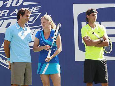 Roger Federer of Switzerland, Kim Clijsters of Belgium and Rafael Nadal from Spain at the Arthur Ashe Kids Day at the US Open tennis tournament in New York, on Saturday