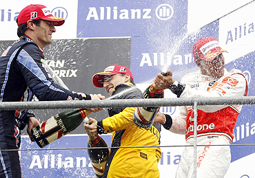 McLaren's Lewis Hamilton (right) sprays champagne with Renault's Robert Kubica (centre) and Red Bull's Mark Webber (left) on the podium