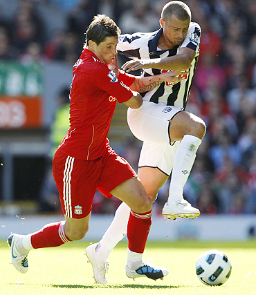 Liverpool's Fernando Torres (left) and West Bromwich Albion's Gabriel Tamas (right) vie for possession