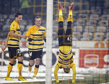 Young Boys Berne's Emmanuel Mayuka (right) celebrates with teammates after scoring against VfB Stuttgart on Wednesday