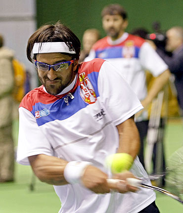 Serbia's Janko Tipsarevic hits a return during a team training session in Belgrade
