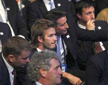 David Beckham and other members of England's bidding team react during the ceremony in Zurich