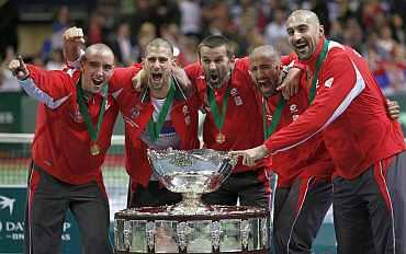 Serbia's Davis Cup team members celebrate after winning the Davis Cup in Belgrade