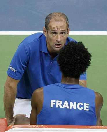 Guy Forget gives instructions to Gael Monfils during his Davis Cup final match against Serbia's Djokovic in Belgrade