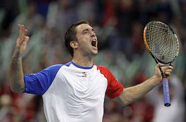 Serbia's Viktor Troicki reacts during his Davis Cup match against France's Michael Llodra in Belgrade