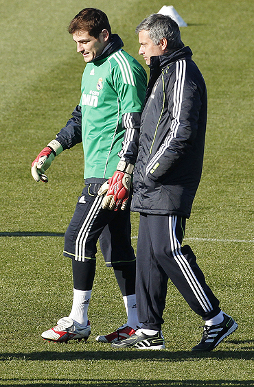 Real Madrid's coach Jose Mourinho (right) with Iker Casillas