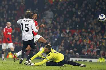 Manchester United's Anderson scores past Valencia's Vicente Guaita during their Champions League Group C match at Old Trafford