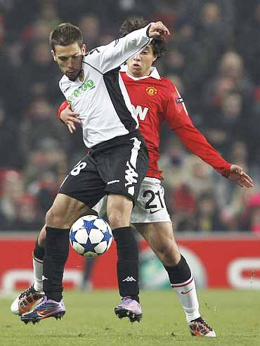 Manchester United's Rafael challenges Valencia's Jordi Alba during their Champions League Group C match at Old Trafford